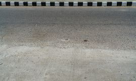 Black and white concrete road curb Royalty Free Stock Image