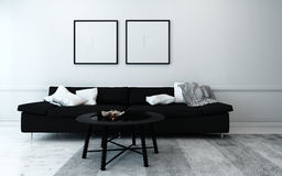 Black and White Contemporary Living Room. Sparsely Decorated Modern Living Room with Black Sofa, Coffee Table, and Artwork Hanging on Wall with White Decor Stock Photo