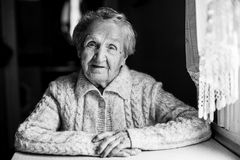 Black and white contrast portrait of an old good woman. Stock Photo