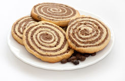 Black and white cookies with coffee beans. On the plate on white background stock images