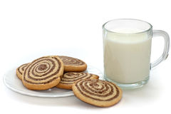 Black and white cookies with cup of milk. Black and white cookies on the plate with cup of milk on white background stock photography