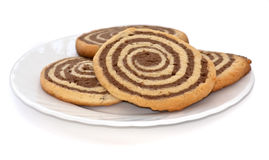 Black and white cookies on the plate. On white backround royalty free stock images