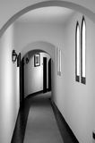 Black and White Corridor. Classic hotel corridor with archs and arched windows. Black and White photo Stock Images