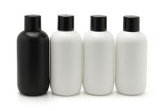 Black and white cosmetic containers Royalty Free Stock Photos