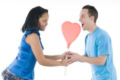 Black and white couple with hearth lollypop Stock Photography
