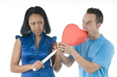 Black and white couple with hearth lollypop Royalty Free Stock Photos