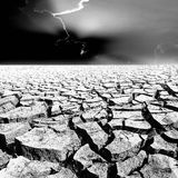 Black and white crack earth with beautiful sky at sunset Stock Image