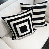 Black and white cushions on a sofa Stock Photography