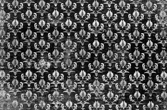 Black and white damask wallpaper. A closeup of a lovely monochrome  antique   shabby  chic damask pattern printed on a paper background Royalty Free Stock Photo