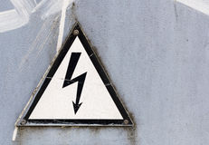 Black and white danger dign with lightning copyspace. Black arrow on white triangle warning sign Stock Images