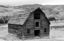 Abandoned Barn in Osoyoos, British Columbia, Canada. Black and white of decayed abandoned barn on farm in Western Canada Stock Image