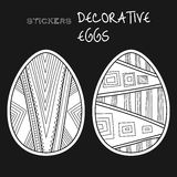 Black, white decorative eggs. Set of stickers on black background. Royalty Free Stock Photo