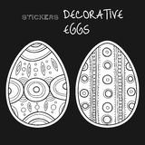 Black, white decorative eggs. Set of stickers on black background. Royalty Free Stock Photography