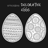 Black, white decorative eggs. Set of stickers on black background. Royalty Free Stock Image