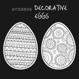 Black, white decorative eggs. Set of stickers on black background. Royalty Free Stock Image