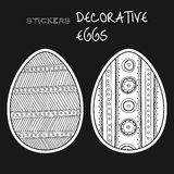 Black, white decorative eggs. Set of stickers on black background. Stock Photos