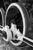 Black and white detail of huge wheels at one old steam locomotiv Royalty Free Stock Images