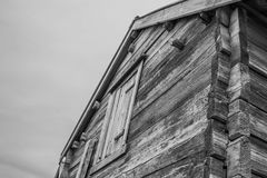 Black and white detail of sea shore abandoned wooden house in a cloudy day Stock Images