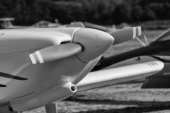 Black and white developed image of the front part of a single engine propeller aircraft. Black and white developed image of the front part of a single engine stock photos