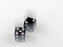 Black and white dice falling Royalty Free Stock Image