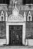 Black and White Door in Venice, Italy. Detail of an old door in Venice, Italy. Black and white photo Royalty Free Stock Photos