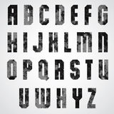 Black and white dotty graphic upper case letters, industrial fon. T Royalty Free Stock Photography