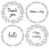 Black and white drawing of wreaths and flowers in a circle with the words Royalty Free Stock Photo