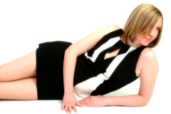Black & White Dress. Woman relaxing on floor wearing black & white dress Royalty Free Stock Photography
