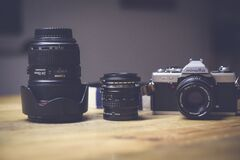 Black and White Dslr Camera Lens Beside Black Lens Stock Photography
