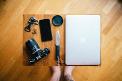 Black and White Dslr Camera Near Space Gray Iphone 6 on Brown Table Royalty Free Stock Image