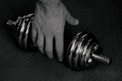 Black and white dumbell with hand Stock Photo