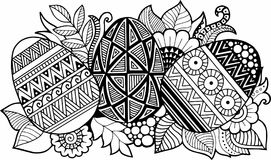 Black-and-white Easter eggs isolated on white. Abstract background made of flowers  and Easter eggs. Royalty Free Stock Photo