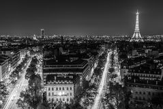 Black and white Eiffel tower. Illuminated Eiffel tower at night seen from the Arc de Triomphe in Paris Stock Photos