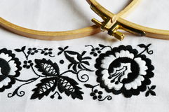 Black and white Embroidery flower. The traditional folklore embroidery next embroidery frame Royalty Free Stock Images