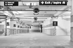 Empty underground parking. Black and white empty underground parking with different indicators Royalty Free Stock Photography