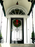 Black and White Entranceway. Door bears a Christmas wreath Stock Photography
