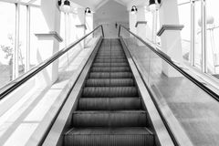 Black and white Escalator. For facilitate people stock image