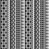 Ethnic geometric motifs background. Black and white ethnic geometric motifs background Stock Illustration