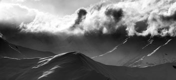 Black and white on evening mountain and sunlight clouds. Black and white panoramic view on evening mountain and sunlight clouds. Caucasus Mountains, Georgia Stock Photography