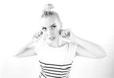 Black and white expressive portrait of a young stylish woman wearing stripes in the studio Stock Photos