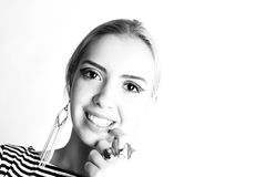 Black and white expressive portrait of a young stylish woman wearing stripes in the studio Royalty Free Stock Photo