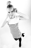 Black and white expressive portrait of a young stylish woman wearing stripes in the studio Royalty Free Stock Images