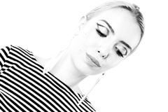 Black and white expressive portrait of a young stylish woman wearing stripes in the studio Royalty Free Stock Photography