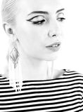 Black and white expressive portrait of a young stylish woman wearing stripes in the studio Stock Photo