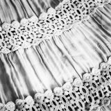 Black-and-white fabric. With the assembly and lace Stock Photos