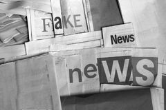 Black and white Fake news on newspapers stock image