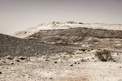 Black and white fantasies of the desert. Rocky hills of the Negev Desert in Israel. Breathtaking landscape of the rock formations in the Southern Israel. Dusty royalty free stock images