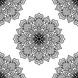 Black and white fantasy seamless pattern with ornamental round doodle flower  on white background. Black outline mandala. Stock Photography