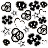 Black and white fashion pattern. Black and white sculls, bones, circles, stars and hearts on the white background Royalty Free Stock Images