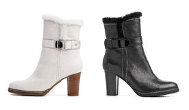 Black and white female winter boots over white. Background Stock Photos